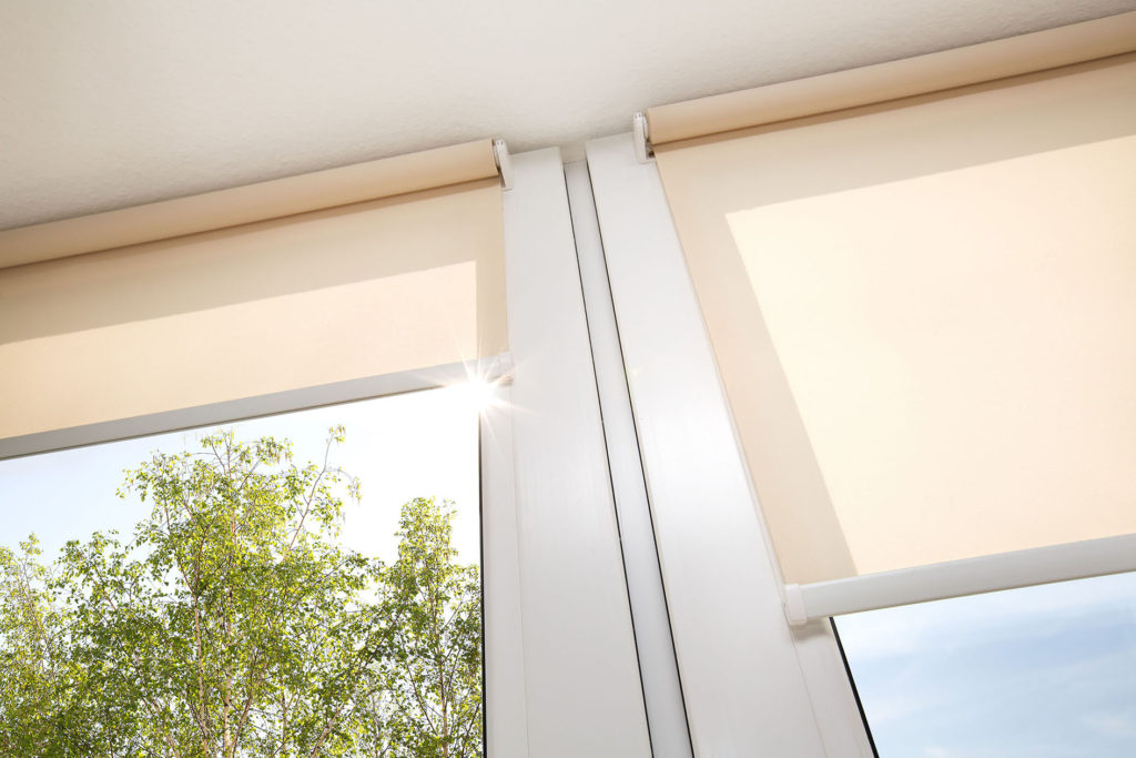 Graphic to show a window with sand coloured roller blinds